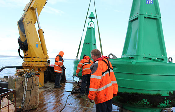Three men carrying out JFC Marine Installation & Servicing